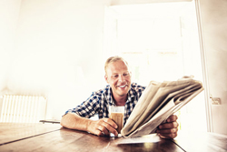Picture Man reading news paper